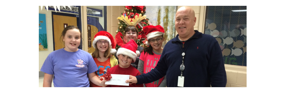 WMES GT students donated funds generated from their Fun Store project to donate to WMES FRC to support needy families for the holidays.