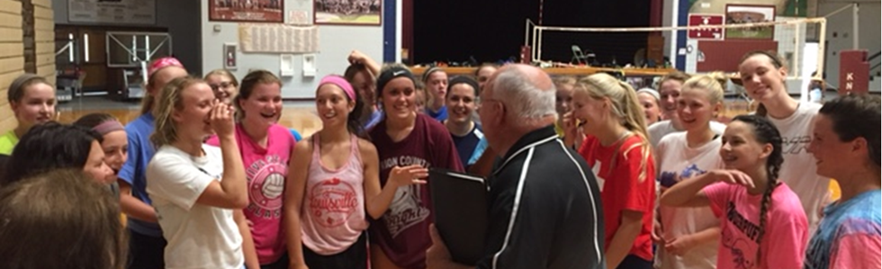 The MCHS volleyball team welcomes interim principal Mr. Brown to MCHS.