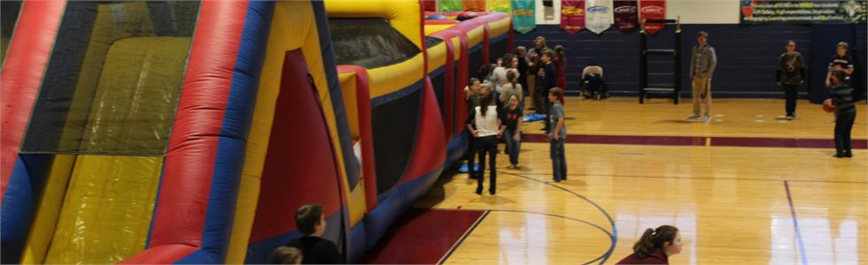 SCMS students enjoying the bouncy as a reward for showing growth on the winter MAP assessment.