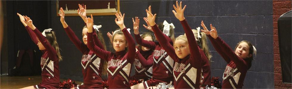 SCMS Jr. Knight cheerleaders show silent support for a player on the free throw line.