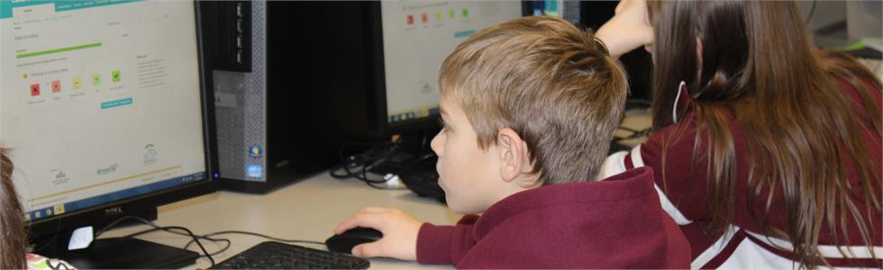 SCMS student Will Hunt completes steps on his ILP (Individual Learning Plan) in the computer lab.