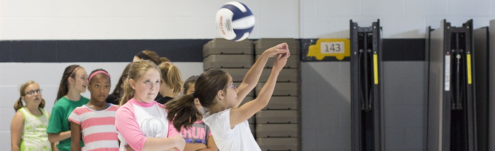 Students learning the fundamentals at the LES Volleyball Summer Camp.