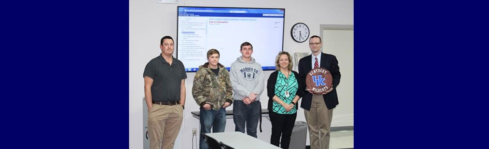 The Marion County Area Technology Center was recognized at the February 9, 2017, board of education meeting for its work with the district's 6 C's initiative.  Students are using communication, collaboration, commitment, creativity, critical thinking, and content to collaborate with other ATC programs to create marketable products for sale in the community.  Pictured (L-R):  CAD CAM Instructor Jason Spalding, MCHS student Aams Mattingly, MCHS student Keith Ballard, MCATC Principal Christina McRay, and BOE member Kaelin Reed.