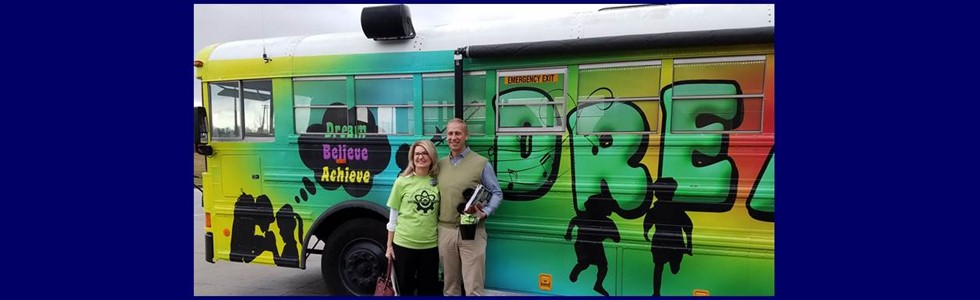 Associate Commissioner David Couch was keynote speaker for the Marion County Innovation Institute on Jan. 17 2017. Pictured here with Superintendent Schlosser in front of the Dream Bus!